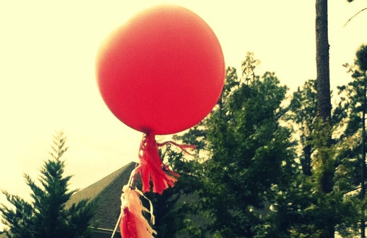 red balloon with tassels for Spring weddings