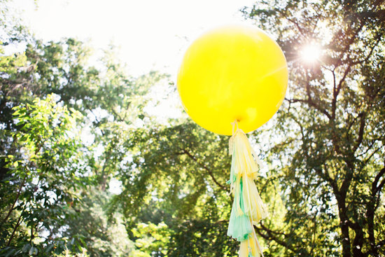 Bright yellow balloon with tassels