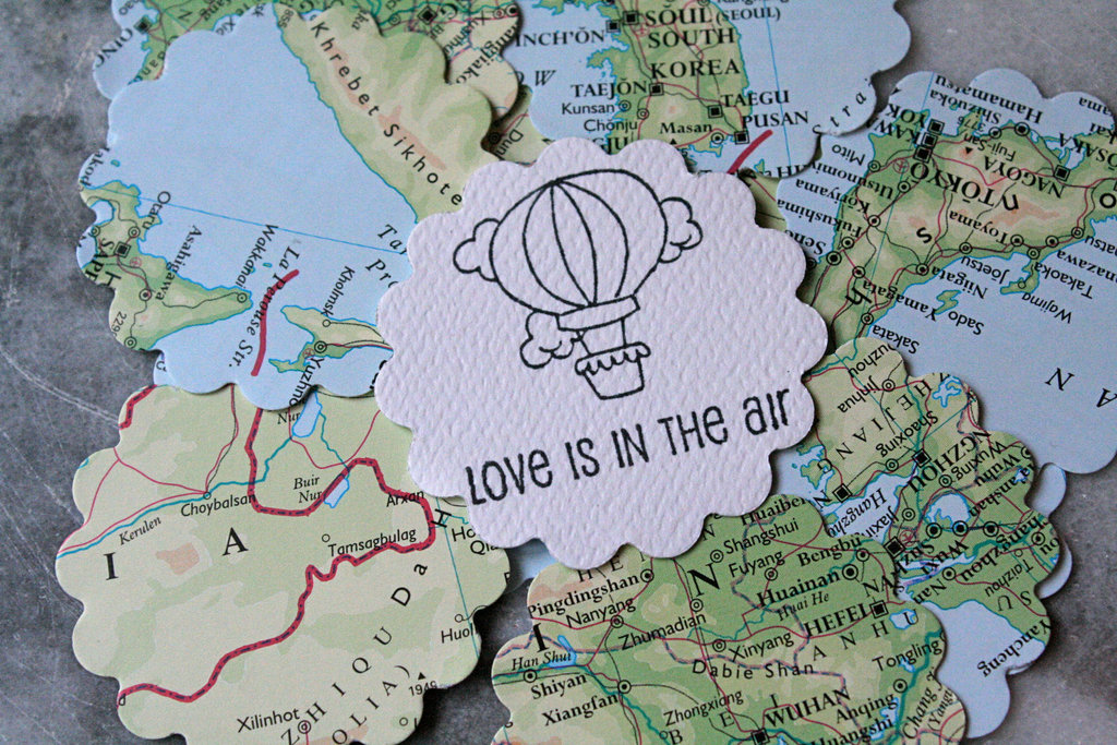 Atlas with hot air balloons wedding table decor