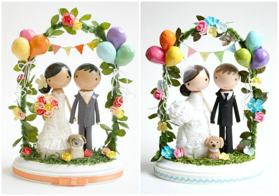 Adorable wedding cake toppers bride and groom beneath arch