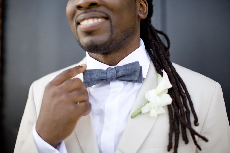 Khaki grooms suit with jean bow tie