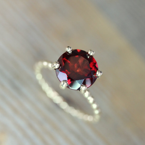Garnet engagement ring with twisted band