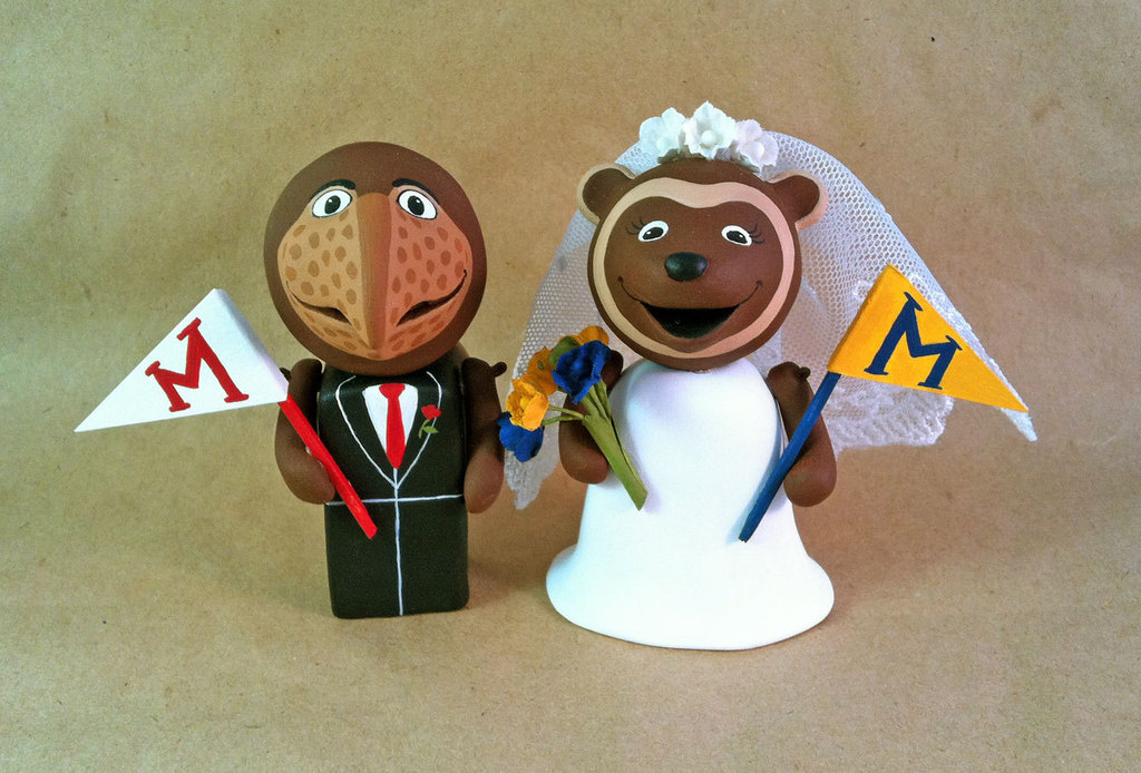 adorable wedding cake topper Michigan alum