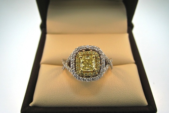 Unique yellow diamond engagement ring with pave diamonds