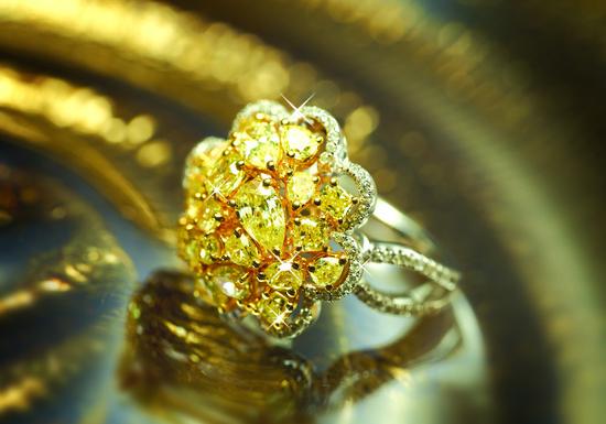 photo of Ornate yellow diamond engagement ring