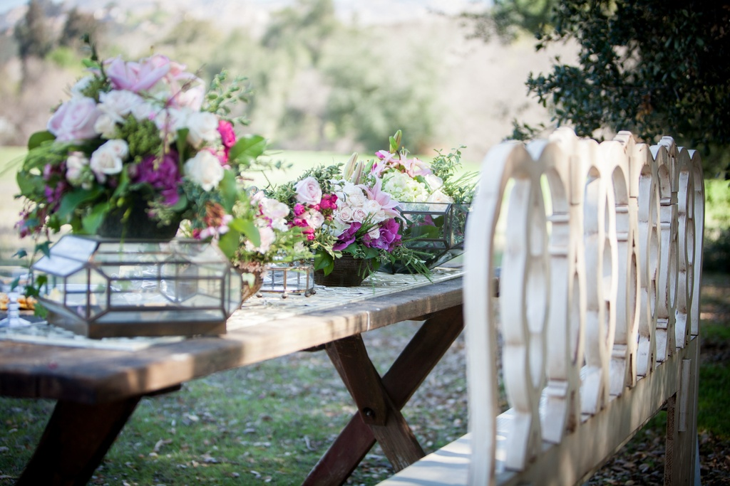 Romantic-outdoor-wedding-reception-table-vintage-chairs.full