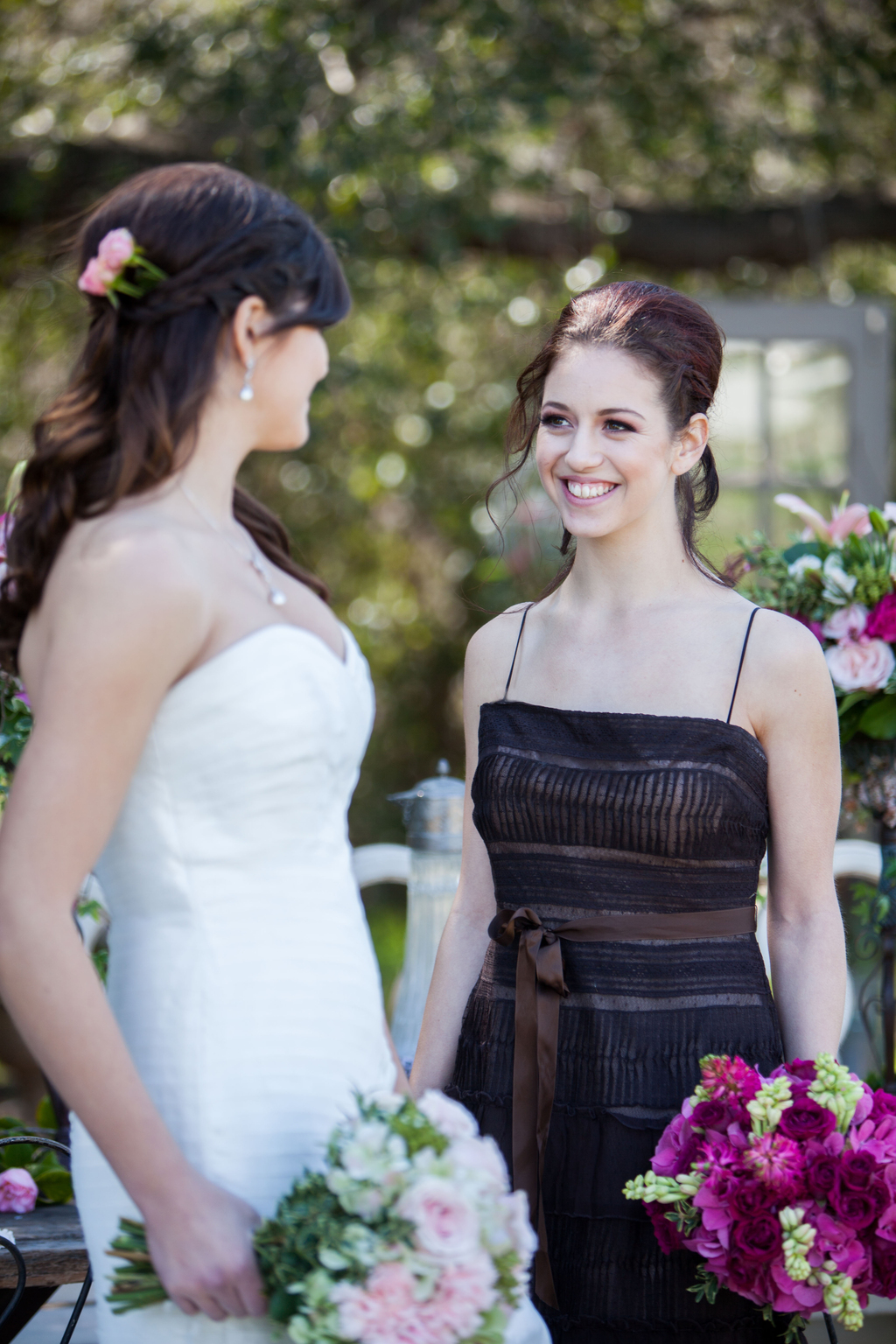 Chic-bridesmaid-in-black-and-chocolate-frock-poses-with-bride.full