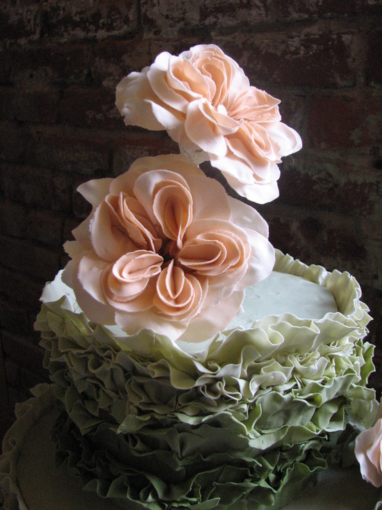 Green and pink ruffly wedding cake