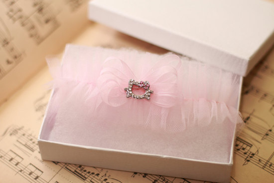 Light pink wedding garter with Hello Kitty detail