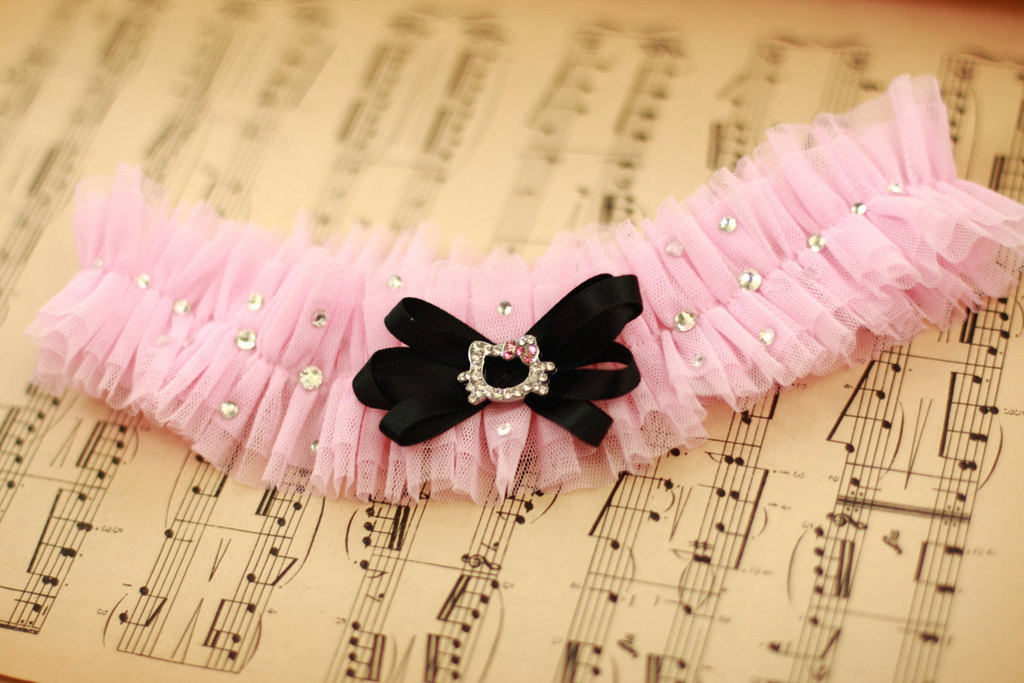 Cotton candy pink wedding garter with black bow