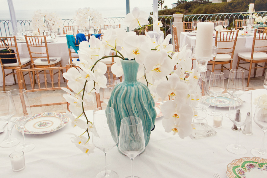 White-orchid-wedding-centerpiece-with-turquoise-vase.full