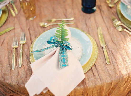 Beautiful wedding reception place setting turquoise and gold