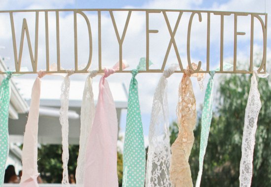 Awesome wedding sign with pastel ribbon accents