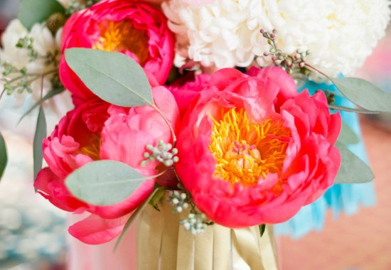 Bright pink peony centerpiece with turuoise touches