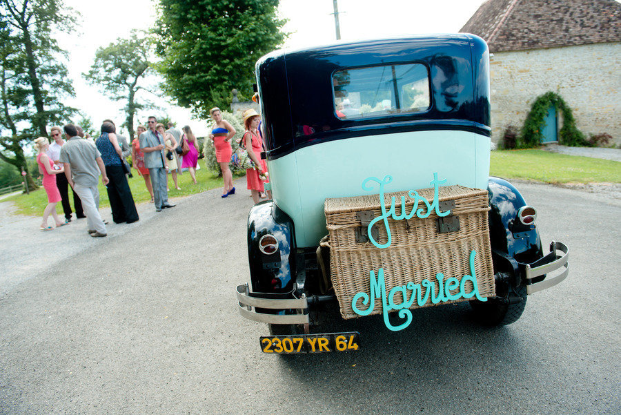 Awesome wedding car with Just Married sign