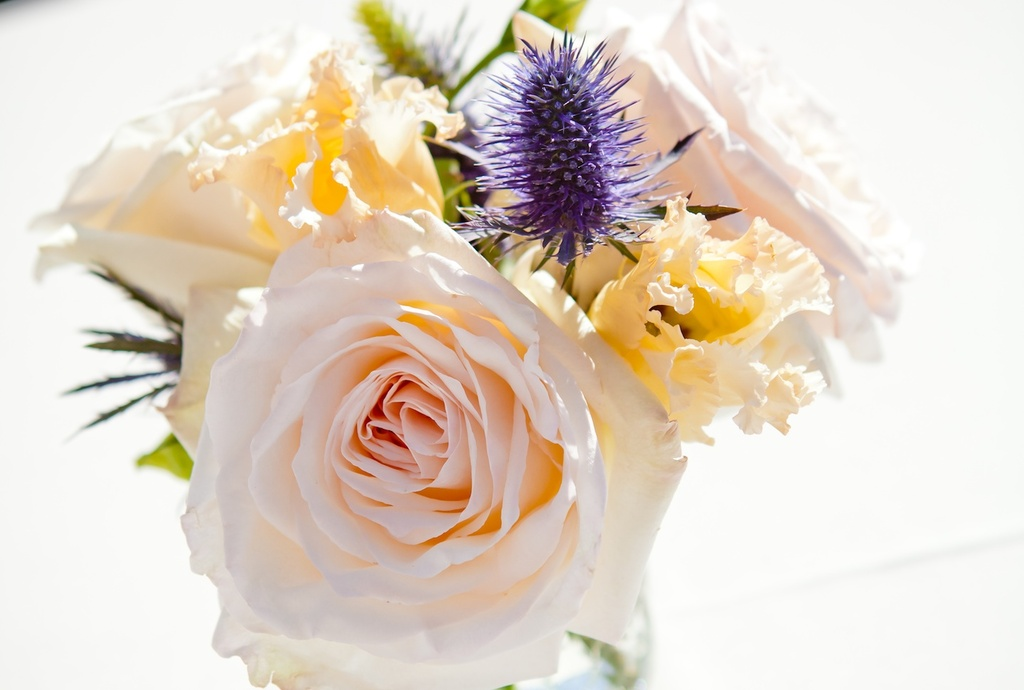 Dreamy wedding centerpiece in pastel peach yellow and lavender