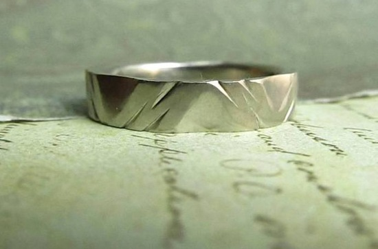 Platinum wedding band with unique cuts