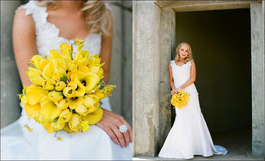 bride in beautiful lace wedding dress holds bright yellow bouquet