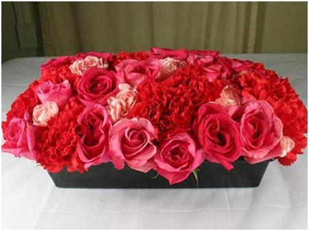 Red and Coral Roses and Carnations together for Table Centerpiece