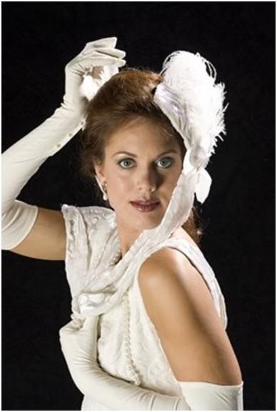 The Cocktail Hat: White hat accented with spray of long feathers