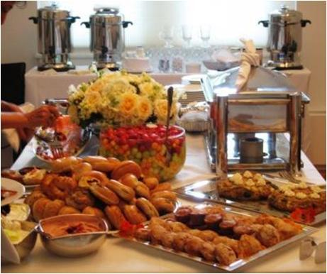 Beautiful brunch table setting with pastries and yellow flowers