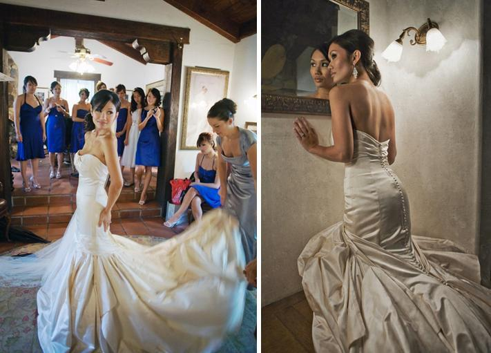 Beautiful bride in off-white, cappucino colored wedding dress with bridesmaids in blue