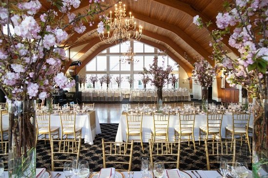 Branchy Cherry Blossom Wedding Centerpieces in Unique Reception Room