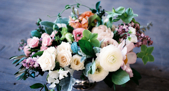 Spring wedding centerpiece with ivory ranunculus