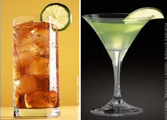 Long island ice tea with lime in clear glass; green apple martini with slice of lime