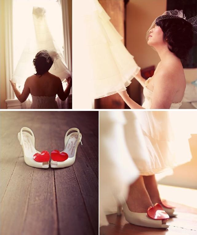 Wedding-shoes-white-with-red-heart-bride-looks-up-at-white-wedding-dress-in-window.full