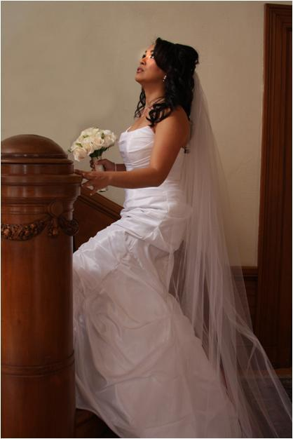 Featured-wedding-saratoga-ca-beautiful-bride-kneels-at-altar-in-white-wedding-dress.full