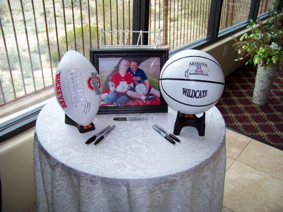 Have guests sign football or basketball at welcome table for Wedding table sign ideas