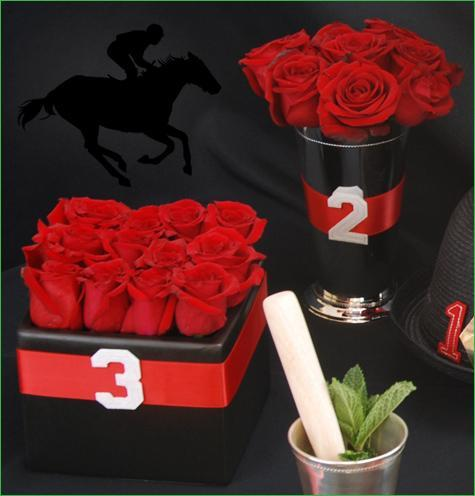 photo of red rose centerpiece in julep cup vase; red rose centerpiece in square cube vase