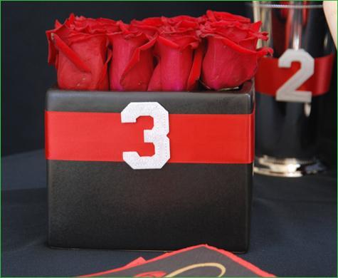 Gorgeous red rose centerpiece in black short cube vase