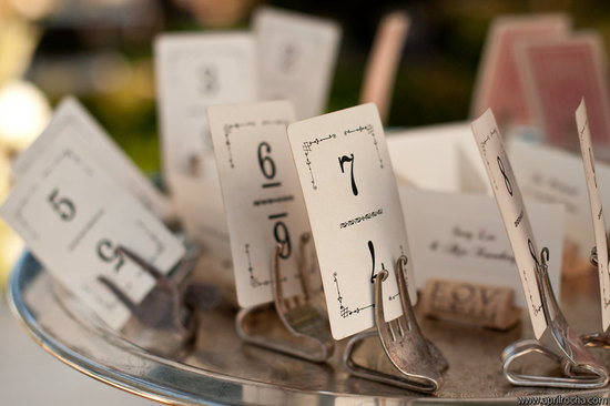vintage forks hold wedding table numbers