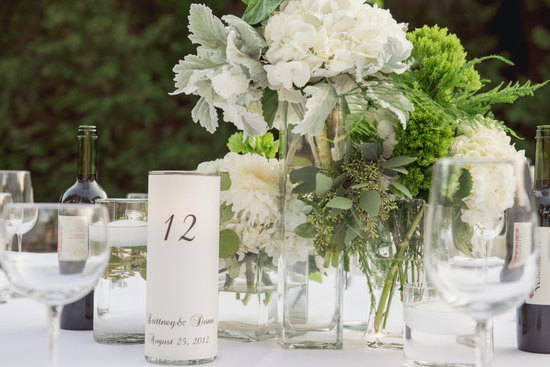 Luminaries table numbers for outdoor wedding