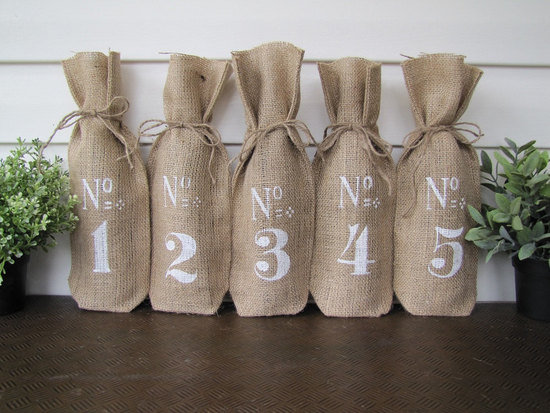 Burlap wine bottle covers for wedding table numbers