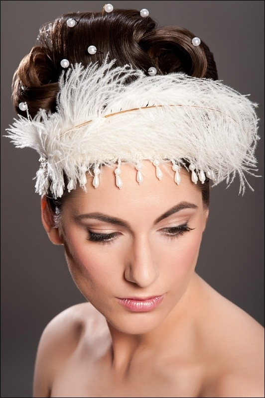 Amy-Jo Tatum Headpieces on Etsy- white feather tiara with pearls hanging down, and throughout hair