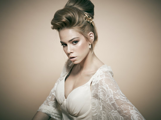 Silky bridal updo high bun with pouf
