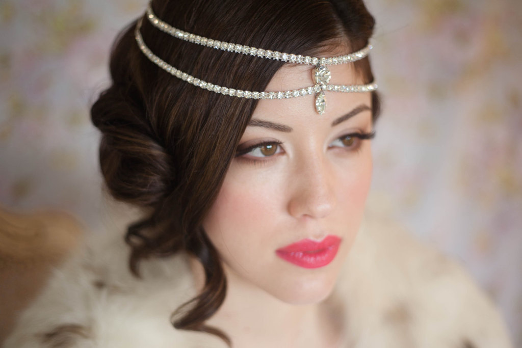 Silky wedding updo with tendrils crystal bridal headdress