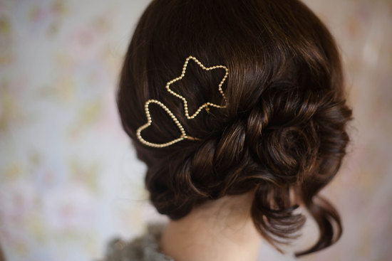 Twisted wedding updo with gold star pins