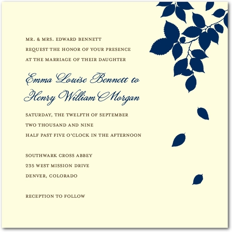White wedding invitation with navy blue leaves and lighter blue writing