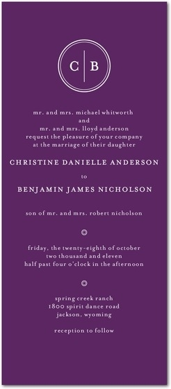 Deep, vibrant purple wedding invitation with white monogram at top