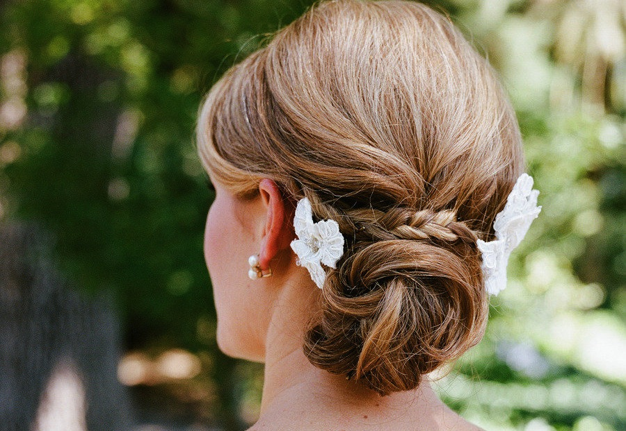 Low Twisted Bun Wedding Hairstyle With Braid | OneWed.com