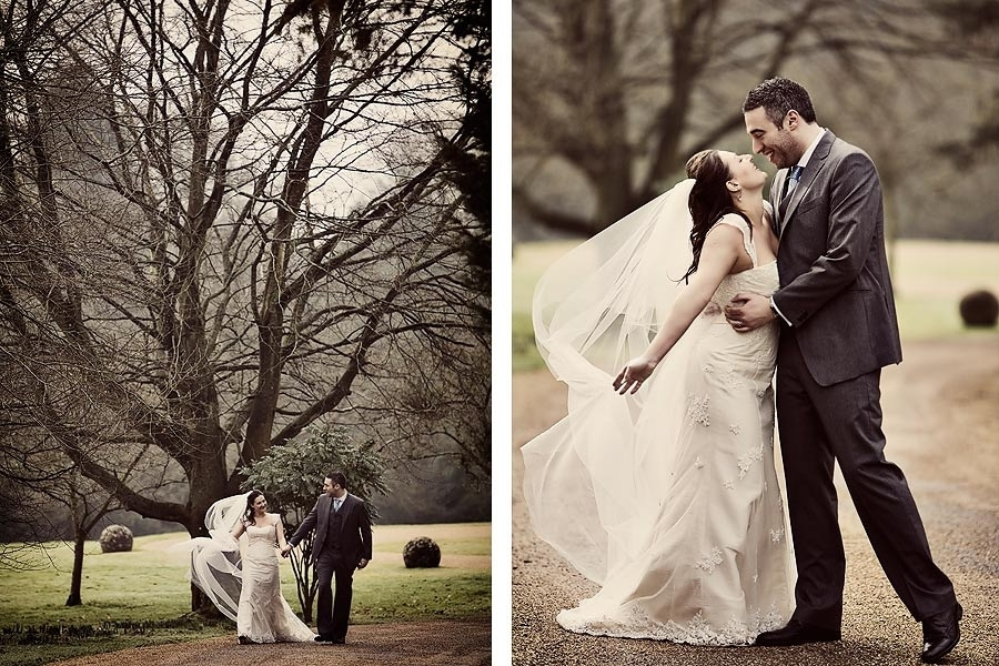 Bride-groom-hold-hands-walk-together-outside-green-grass-gravel-path.full