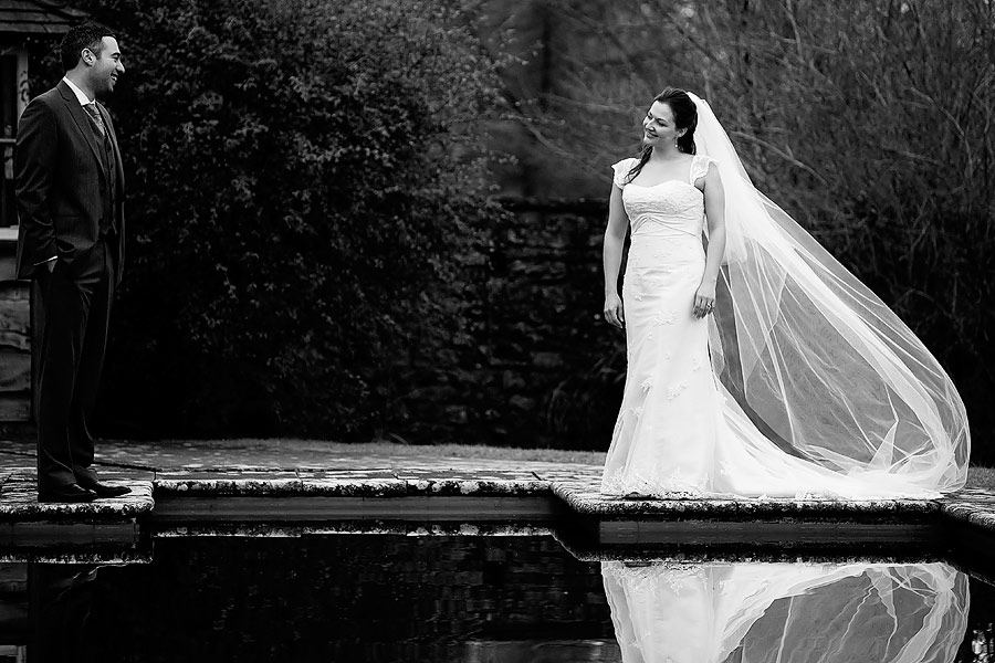 Wedding-photography-black-and-white-bride-groom-smile-at-each-other-outside-lake.full