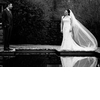 Wedding-photography-black-and-white-bride-groom-smile-at-each-other-outside-lake.square