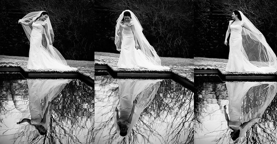 Bride in white wedding dress and veil poses outside pool, reflection
