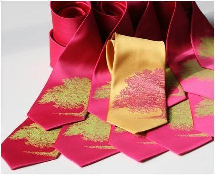 Bright, stylish ties in pink and gold with pink and green nature details
