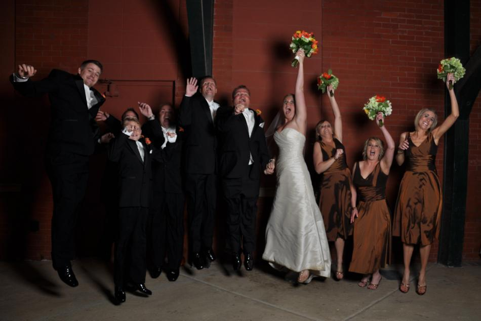 The wedding party jumps for joy
